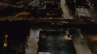 DX0002_210_057 - 5.7K stock footage aerial video of light traffic on the Inner Loop at night, Downtown Rochester, New York