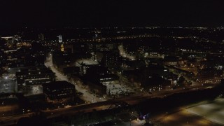 DX0002_210_058 - 5.7K stock footage aerial video fly away from and by office buildings and the Inner Loop at night, Downtown Rochester, New York