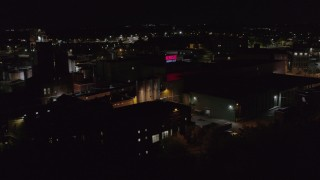 DX0002_210_059 - 5.7K stock footage aerial video of orbiting a brewery at night, Rochester, New York