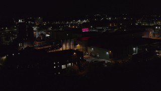 DX0002_210_060 - 5.7K stock footage aerial video of an orbit of a brewery at night, Rochester, New York