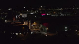DX0002_210_061 - 5.7K stock footage aerial video of approaching a brewery at night, Rochester, New York