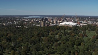 DX0002_211_003 - 5.7K stock footage aerial video of flyby cemetery, Carrier Dome and Downtown Syracuse, New York