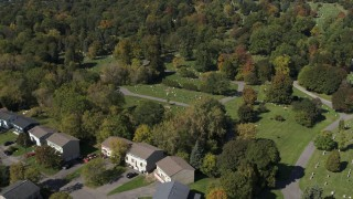 DX0002_211_007 - 5.7K stock footage aerial video approach and orbit graves at Morningside Cemetery near homes in Syracuse, New York
