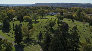 DX0002_211_011 - 5.7K stock footage aerial video of descending near gravestones at Morningside Cemetery in Syracuse, New York