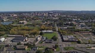 DX0002_211_014 - 5.7K stock footage aerial video of Downtown Syracuse, New York seen from across the city