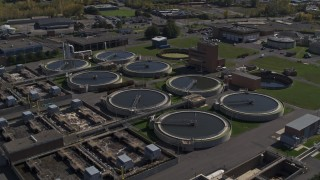 DX0002_211_016 - 5.7K stock footage aerial video of orbiting a sewage treatment plant in Syracuse, New York