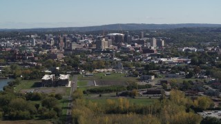 DX0002_211_019 - 5.7K stock footage aerial video of flying by Downtown Syracuse, New York seen from across the city
