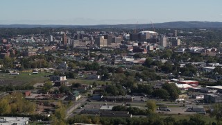 DX0002_211_021 - 5.7K stock footage aerial video of Downtown Syracuse, New York seen from across the city