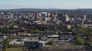 DX0002_212_004 - 5.7K stock footage aerial video ascend for wide view of the city's downtown area, Downtown Syracuse, New York