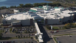 DX0002_212_024 - 5.7K stock footage aerial video a reverse view of the Destiny USA shopping mall, Syracuse, New York