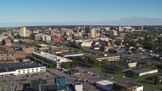 DX0002_212_029 - 5.7K stock footage aerial video of the city's downtown area while ascending by office buildings, Downtown Syracuse, New York