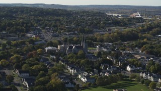 DX0002_213_003 - 5.7K stock footage aerial video of flying by church and a neighborhood in Syracuse, New York