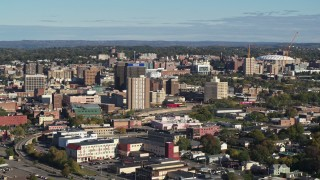 DX0002_213_009 - 5.7K stock footage aerial video of slowly flying by office buildings in Downtown Syracuse, New York