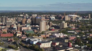 DX0002_213_010 - 5.7K stock footage aerial video of slowly passing by office buildings in Downtown Syracuse, New York