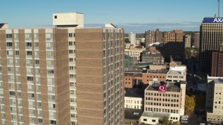 DX0002_213_019 - 5.7K stock footage aerial video flyby downtown and reveal apartment building, Downtown Syracuse, New York