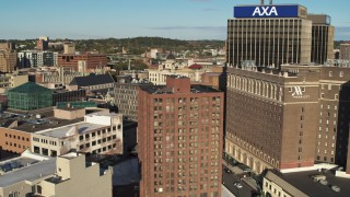 DX0002_213_021 - 5.7K stock footage aerial video of flying by hotel and office buildings, Downtown Syracuse, New York