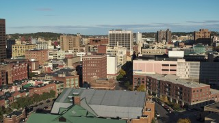DX0002_213_023 - 5.7K stock footage aerial video of descending past office buildings, Downtown Syracuse, New York
