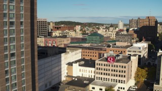 DX0002_213_024 - 5.7K stock footage aerial video of passing by an apartment building to reveal office buildings, Downtown Syracuse, New York