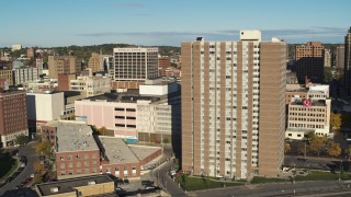 DX0002_213_025 - 5.7K stock footage aerial video of passing by office buildings to reveal an apartment high-rise, Downtown Syracuse, New York