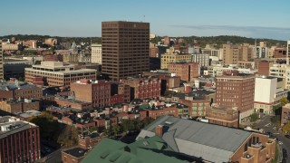 DX0002_213_041 - 5.7K stock footage aerial video of circling the Chase Tower office high-rise, reveal apartment building, Downtown Syracuse, New York