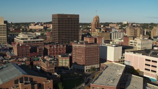 DX0002_213_042 - 5.7K stock footage aerial video pass apartment building to reveal Chase Tower, Downtown Syracuse, New York