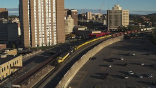 DX0002_214_006 - 5.7K stock footage aerial video orbit and approach a train in Downtown Syracuse, New York
