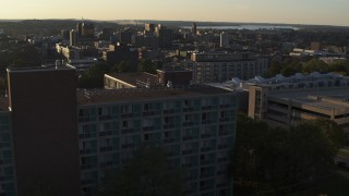 DX0002_214_008 - 5.7K stock footage aerial video ascending by Dellplain Hall at Syracuse University at sunset, New York