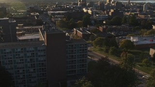DX0002_214_009 - 5.7K stock footage aerial video of orbiting Dellplain Hall at Syracuse University at sunset, New York