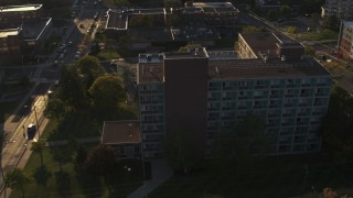 DX0002_214_012 - 5.7K stock footage aerial video of orbiting Booth Hall at Syracuse University at sunset, New York