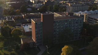DX0002_214_013 - 5.7K stock footage aerial video of circling Booth Hall at Syracuse University at sunset, New York
