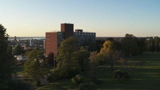 DX0002_214_014 - 5.7K stock footage aerial video focus on Booth Hall while descending at Syracuse University at sunset, New York