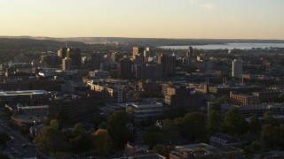 DX0002_214_015 - 5.7K stock footage aerial video of downtown seen from Syracuse University at sunset, New York