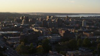 DX0002_214_016 - 5.7K stock footage aerial video of flying by downtown seen from Syracuse University at sunset, New York