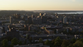 DX0002_214_017 - 5.7K stock footage aerial video of passing by downtown seen from Syracuse University at sunset, New York