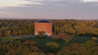 DX0002_214_030 - 5.7K stock footage aerial video of an orbit of the Stewart Stand Pipe at Thornden Park, Syracuse at sunset, New York