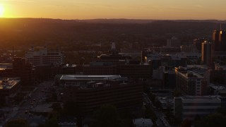 DX0002_214_033 - 5.7K stock footage aerial video orbit Crouse Hospital in Downtown Syracuse at sunset, New York