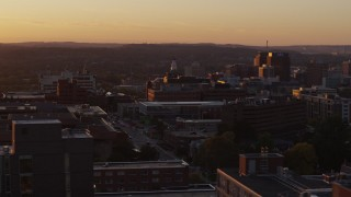 DX0002_214_034 - 5.7K stock footage aerial video a wide orbit of Crouse Hospital in Downtown Syracuse at sunset, New York