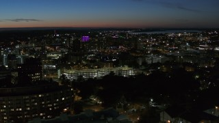 DX0002_215_005 - 5.7K stock footage aerial video city buildings in Downtown Syracuse at twilight, seen from university, New York