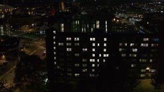 DX0002_215_009 - 5.7K stock footage aerial video of orbiting university dormitory at twilight, Syracuse, New York