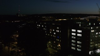 DX0002_215_010 - 5.7K stock footage aerial video of circling university dormitory at twilight, Syracuse, New York