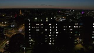 DX0002_215_012 - 5.7K stock footage aerial video of the Dellplain Hall university dormitory at twilight, Syracuse, New York