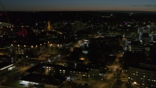 DX0002_215_014 - 5.7K stock footage aerial video orbit Syracuse University campus buildings at twilight, Syracuse, New York