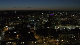 DX0002_215_016 - 5.7K stock footage aerial video a view across Syracuse University at twilight to Downtown Syracuse, New York