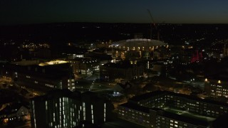 DX0002_215_020 - 5.7K stock footage aerial video of circling Carrier Dome and Syracuse University at twilight, Syracuse, New York