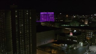 DX0002_215_029 - 5.7K stock footage aerial video orbit Barclay Damon Tower and apartment complex at night, Downtown Syracuse, New York