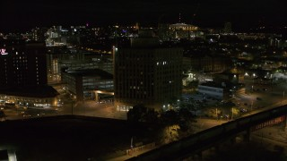 DX0002_215_030 - 5.7K stock footage aerial video of orbiting a dark office building at night, Downtown Syracuse, New York