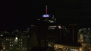 DX0002_215_033 - 5.7K stock footage aerial video orbit office tower and hotel at night, reveal apartment complex, Downtown Syracuse, New York