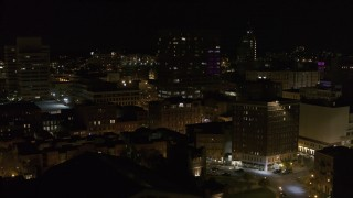 DX0002_215_040 - 5.7K stock footage aerial video flyby apartment building at night, reveal One Lincoln Center, Downtown Syracuse, New York