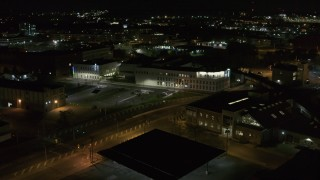 DX0002_215_044 - 5.7K stock footage aerial video of approaching an office building at night, Downtown Syracuse, New York