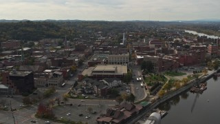 DX0002_216_002 - 5.7K stock footage aerial video orbit and fly away from downtown area of Troy, New York